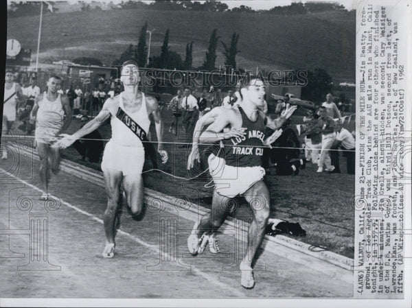 1962 Jim Beatty, Champion Runner of the AAU Mile Run - Historic Images