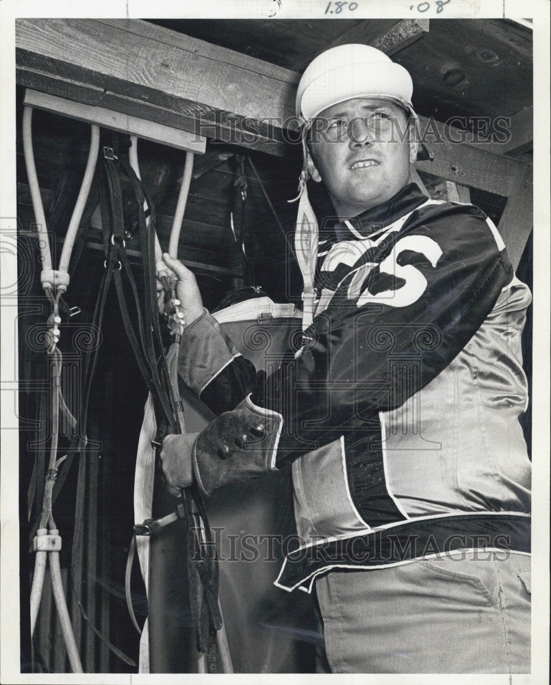1969 Press Photo Driver Don Stratton prepares gear for Foxboro opener - Historic Images