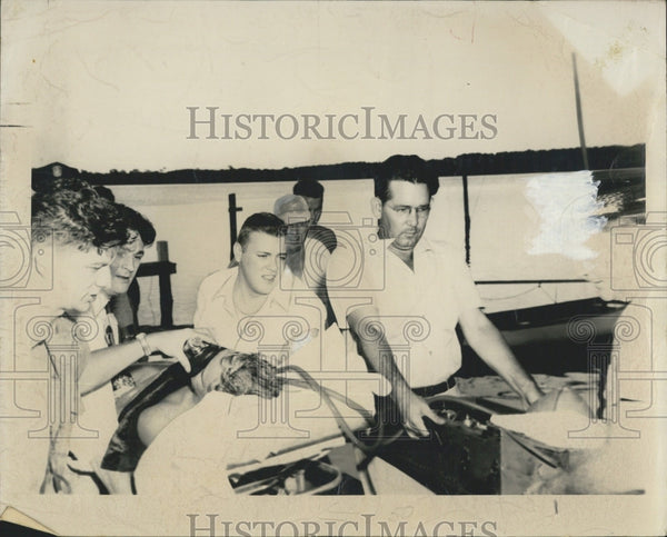 1950 Press Photo Firefighter Helps David Walker in Ambulance - Historic Images