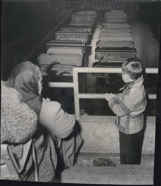 1958 Small Boy Looks At Rows of Caskets - Historic Images