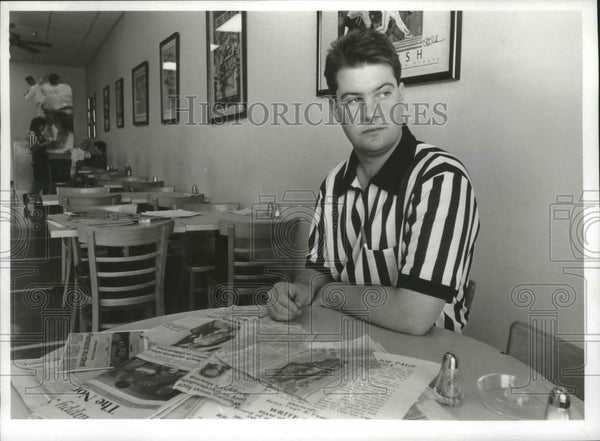 Press Photo Rodney Page Sits at Table Strewn With Clips on Dad's Murder - Historic Images