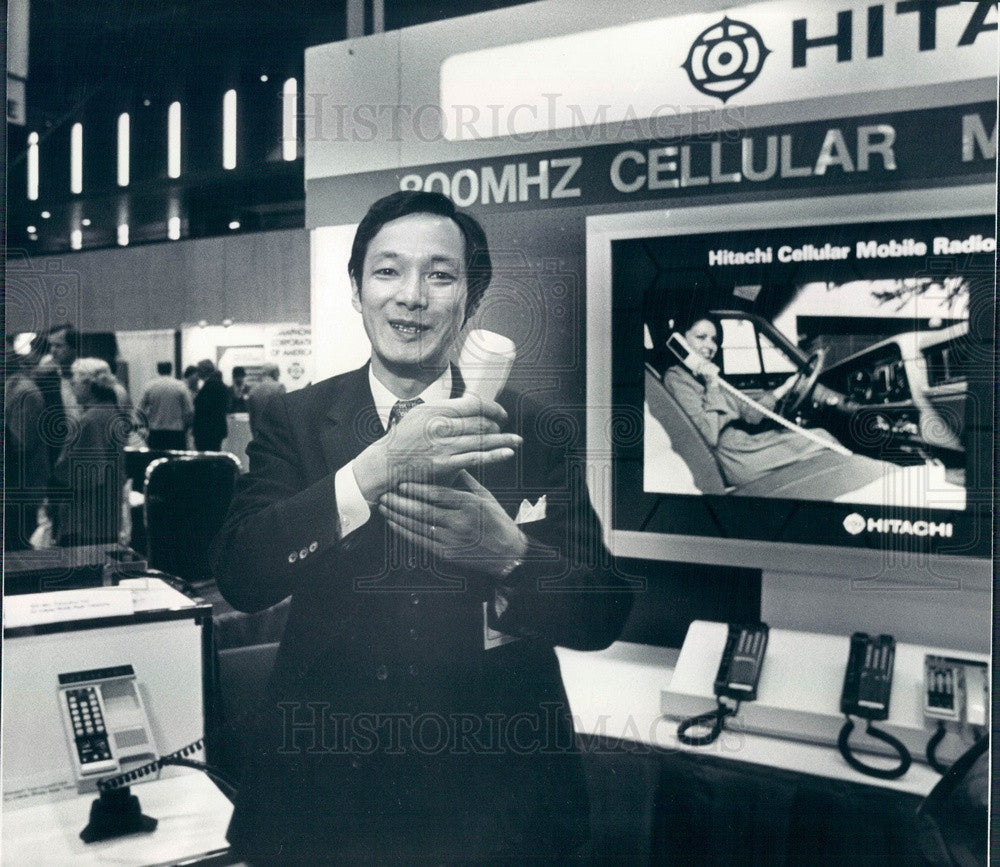 1983 Hitachi Rep Hiroshi Arai & Headset for Mobile Phones Press Photo - Historic Images