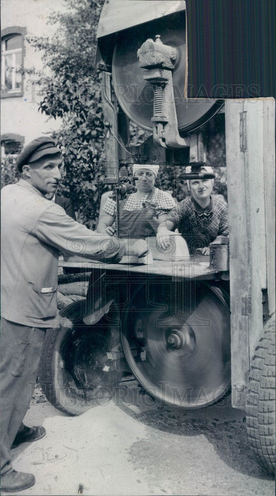 1945 Schuluchtern, Germany Man Cutting Firewood Press Photo - Historic Images