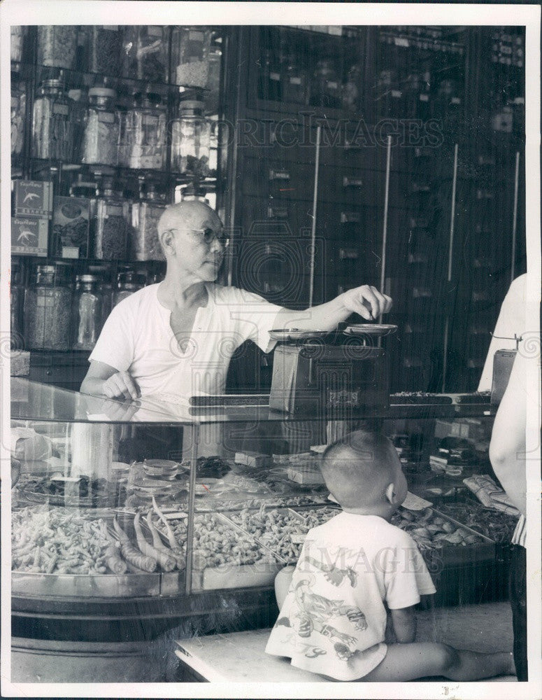 1965 Bangkok, Thailand Chinatown Vendor Weighing Medicines Press Photo - Historic Images