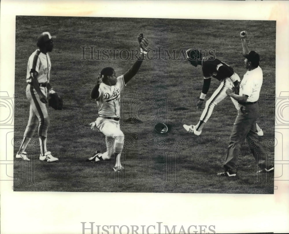 Press Photo Umpire Calls and Out as Dodger Player Attempts Out - cvb62511 - Historic Images
