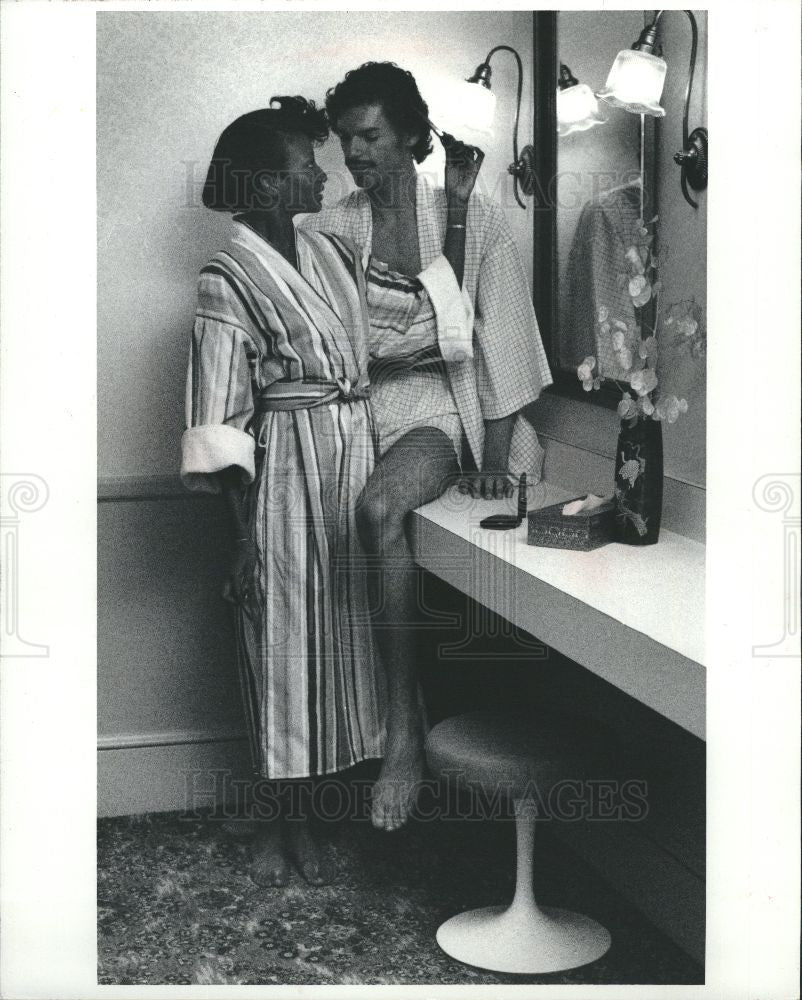 1983 Press Photo Ads barely use scantly dressed male. - Historic Images