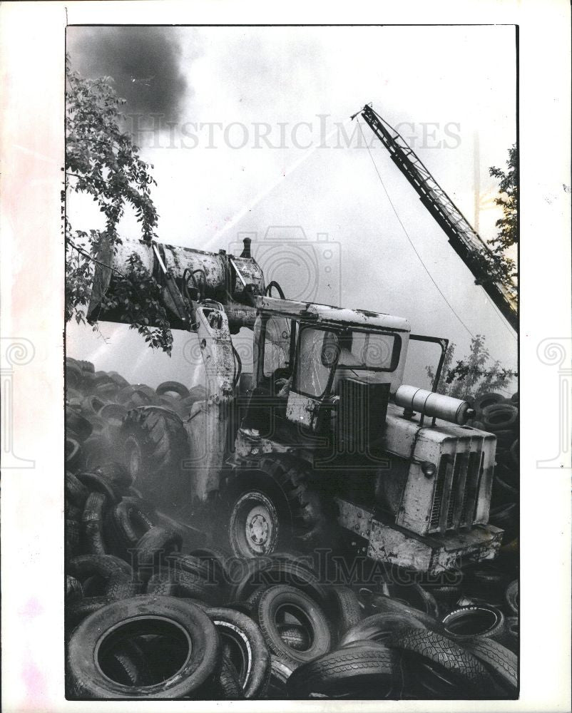 1990 Press Photo fire extinguished tire - Historic Images