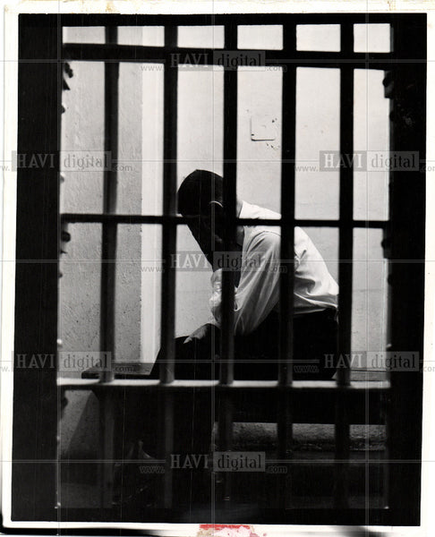 Press Photo Prison Hands on face Grief - Historic Images