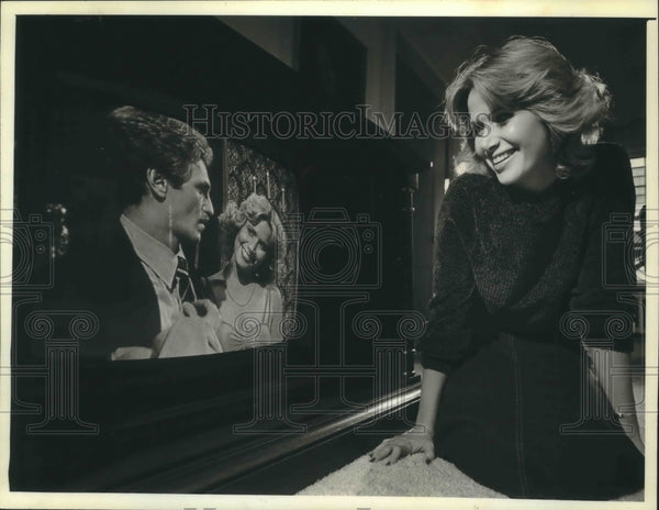 "1979 Press Photo Christian Meadows watches herself star in ""One Life to Live"" - Historic Images"