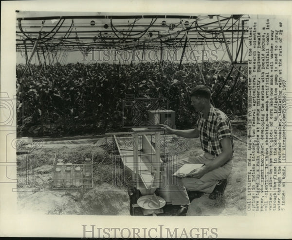1957 Press Photo Engineer rigs up a rain machine at Purdue University, Indiana - Historic Images