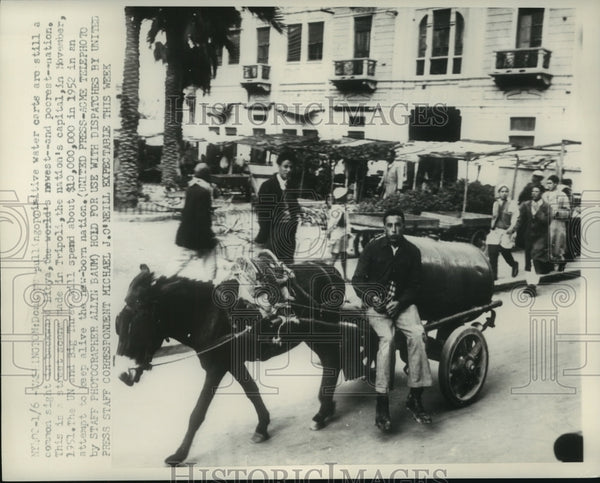 1952 Press Photo Donkeys pulling water carts Tripoli, Libya - mjc21969 - Historic Images