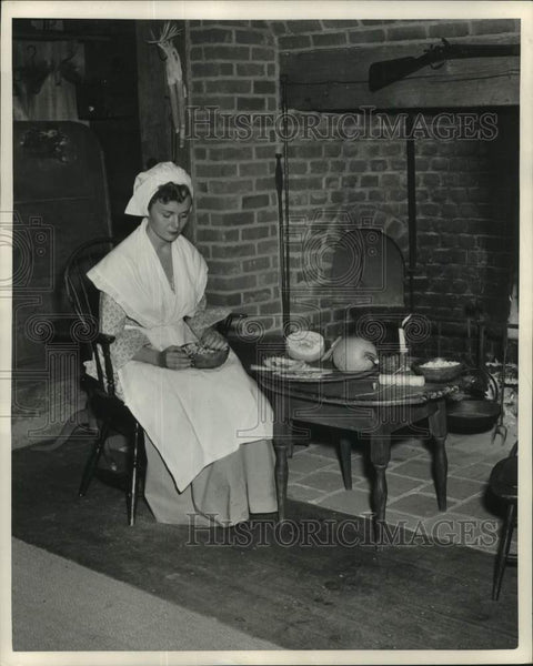 1951 Press Photo Lady Cooking by Candle in Old Sturbridge Reconstructed Home - Historic Images