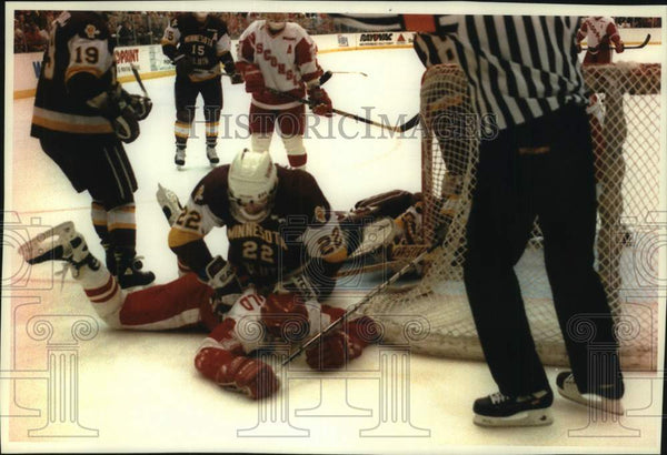 1994 Press Photo Greg Hanson and Kelley Fairchild during hockey game - mjc33673 - Historic Images