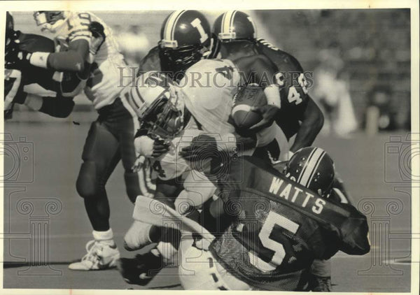 1992 Press Photo University of Wisconsin player Jason Burns gets slammed on run. - Historic Images