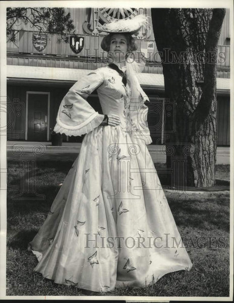 1929 Actress Kim Hunter in old fashion gown stands in front of tree - Historic Images
