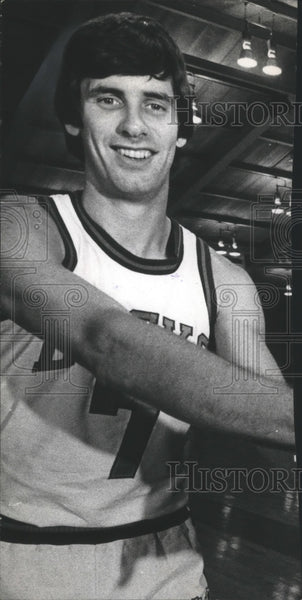 Terry Driscoll in his basketball uniform. - Historic Images