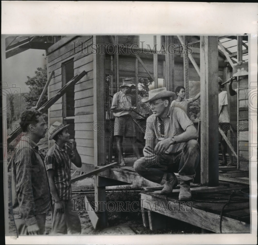 1964 American volunteer Gus Carlson supervised construction in Laos - Historic Images