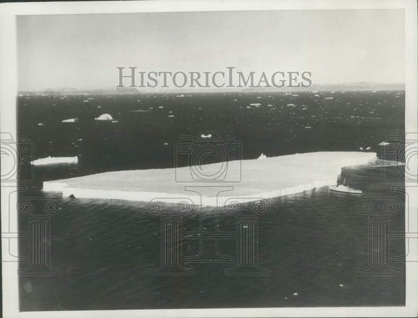 1957 Press Photo U.S. Westwind seen beside the three-quarters of a mile iceberg. - Historic Images