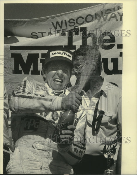 1984 Press Photo Tom Sneva celebrates winning the Dana-Rex Mays 200 - mjx57087 - Historic Images