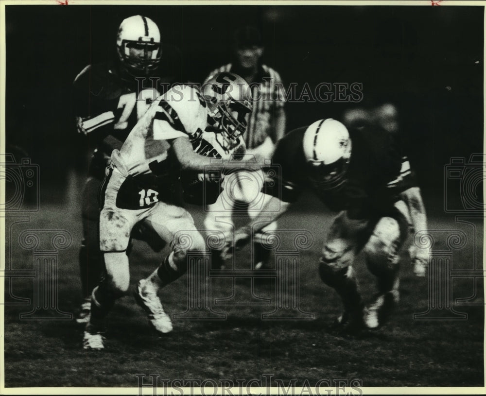 1984 Press Photo Southwest and Clemens High School Football Players at Game - Historic Images