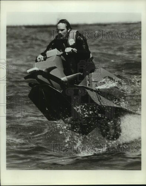 Press Photo A rider goes airborne with a personal watercraft - sas16020 - Historic Images
