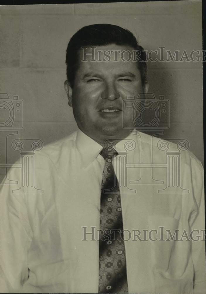 Press Photo A man in a shirt and tie poses for a photo - sas16914 - Historic Images