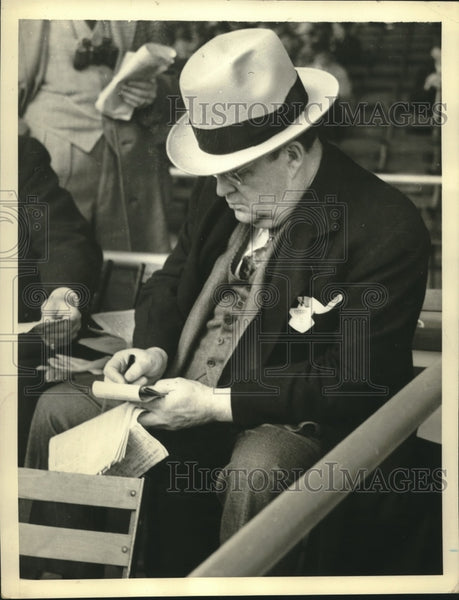 Press Photo Assistant Postmaster General W.W. Howes Picks Rag to Carry Mail In - Historic Images