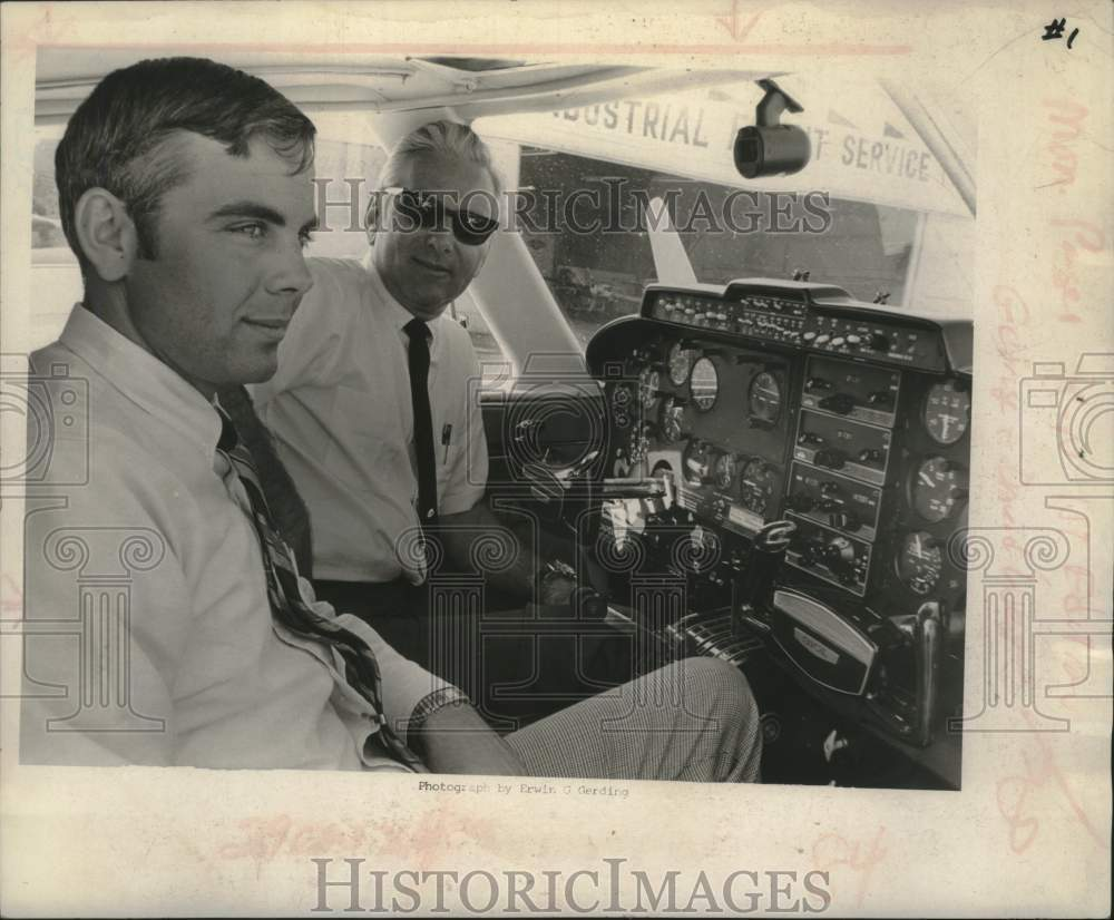 1969 George and David West in cockpit of airplane - Historic Images