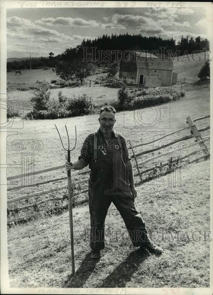Press Photo Farmer poses for photograph in Nova Scotia, Canada - tua14745 - Historic Images