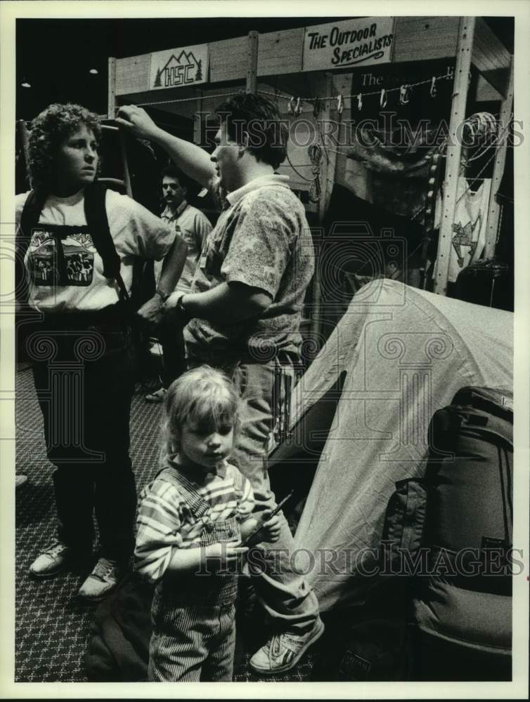 1989 Press Photo Vermont woman fitted with backpack at Albany, New York expo - Historic Images
