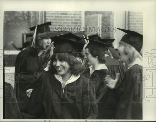 Press Photo Students in graduation caps and gowns. Risage - tua15105 - Historic Images