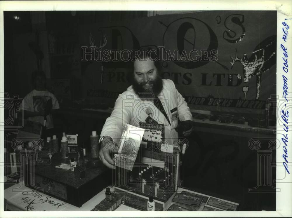 Press Photo Dr. O shows off deer scents at wildlife expo in Albany, New York - Historic Images