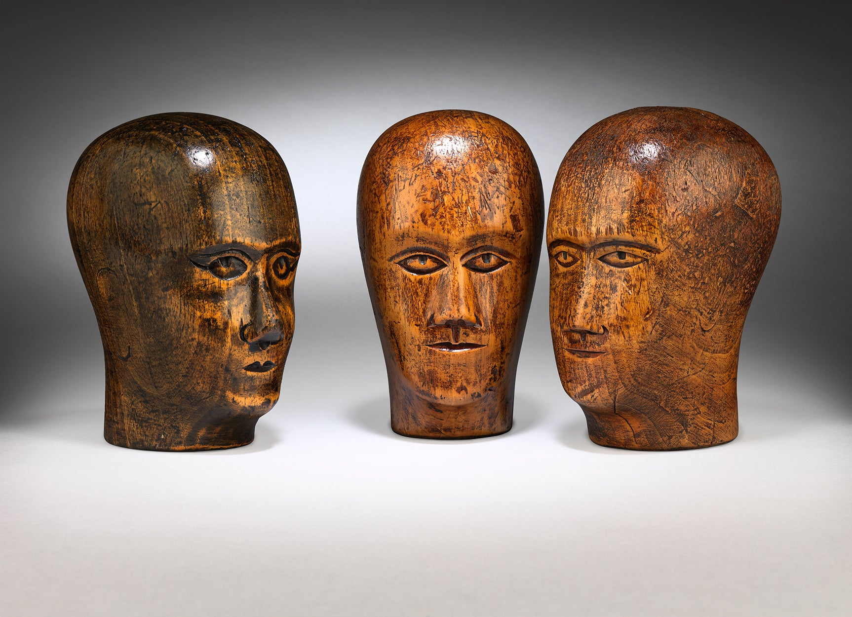 A Group of Three Milliner's Heads
