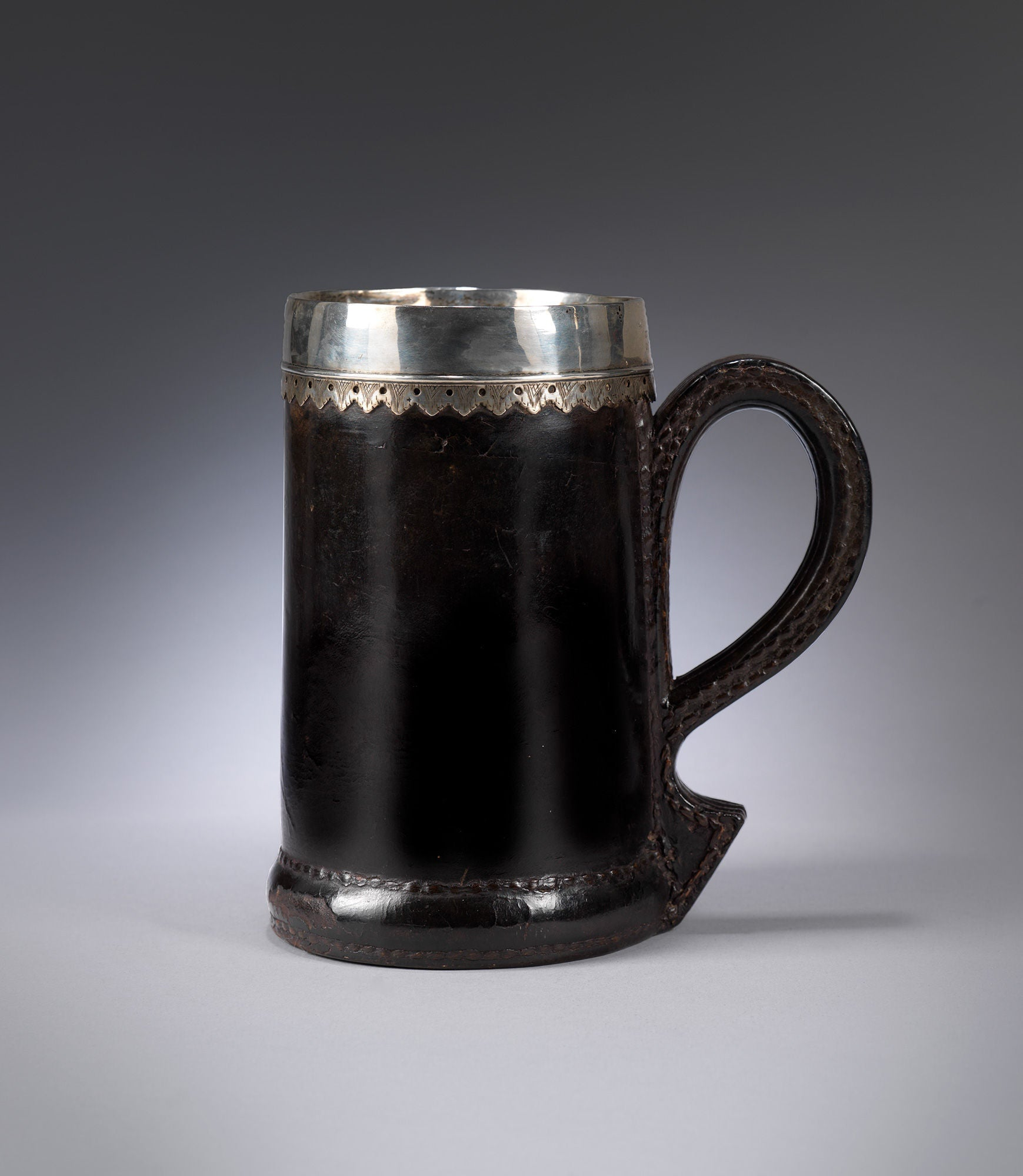"Exemplary Early Silver Mounted ""Black Jack"" or Tankard"