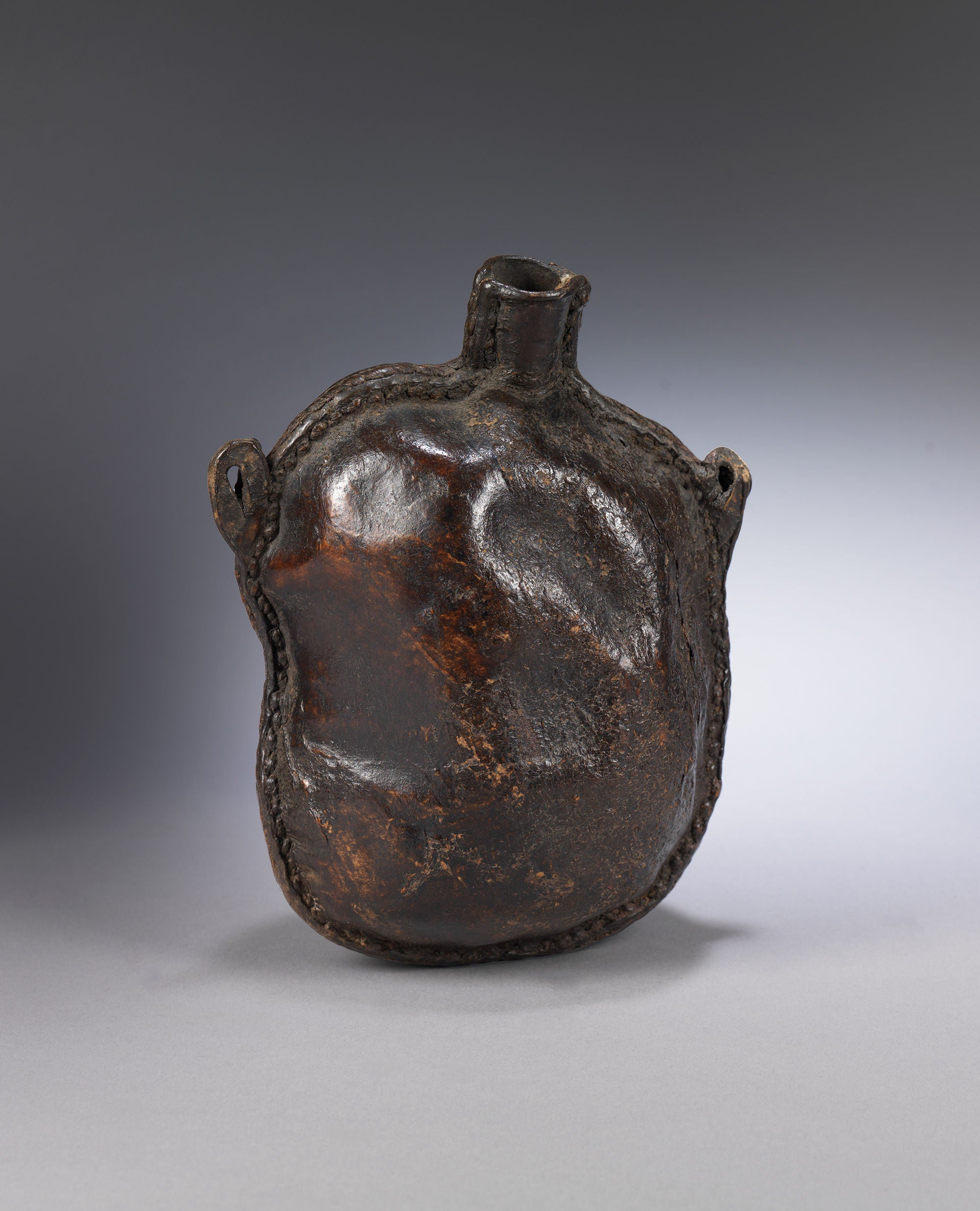 "Richly Patinated Early Spouted Drinking ""Bottel"""