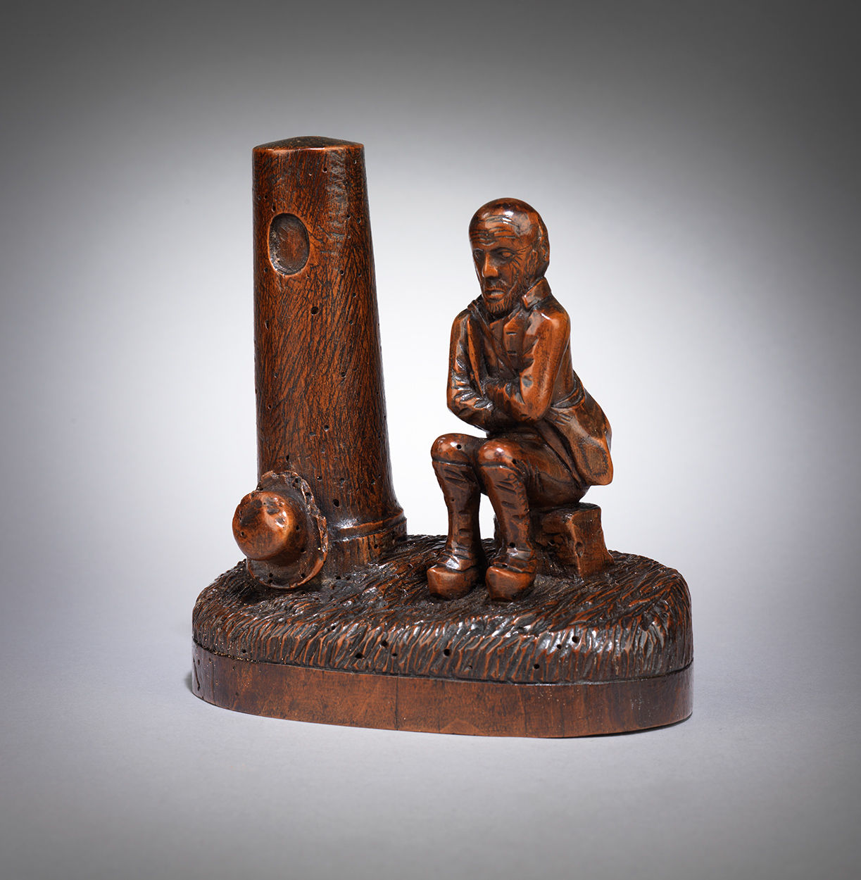 Naive Folk Art Carving of a Man Seated Beside a Tower