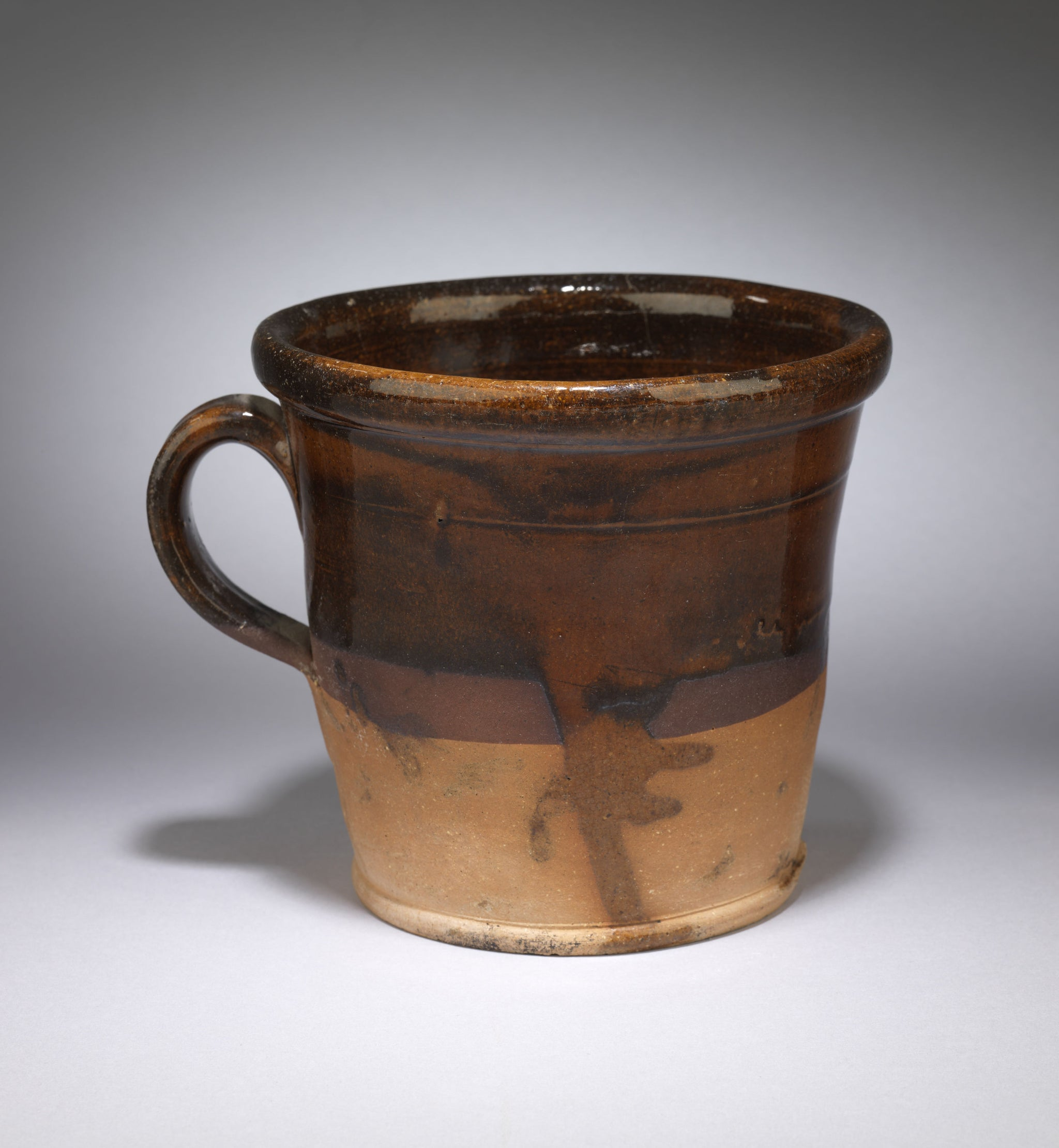 A Loop Handled Slipware Crock