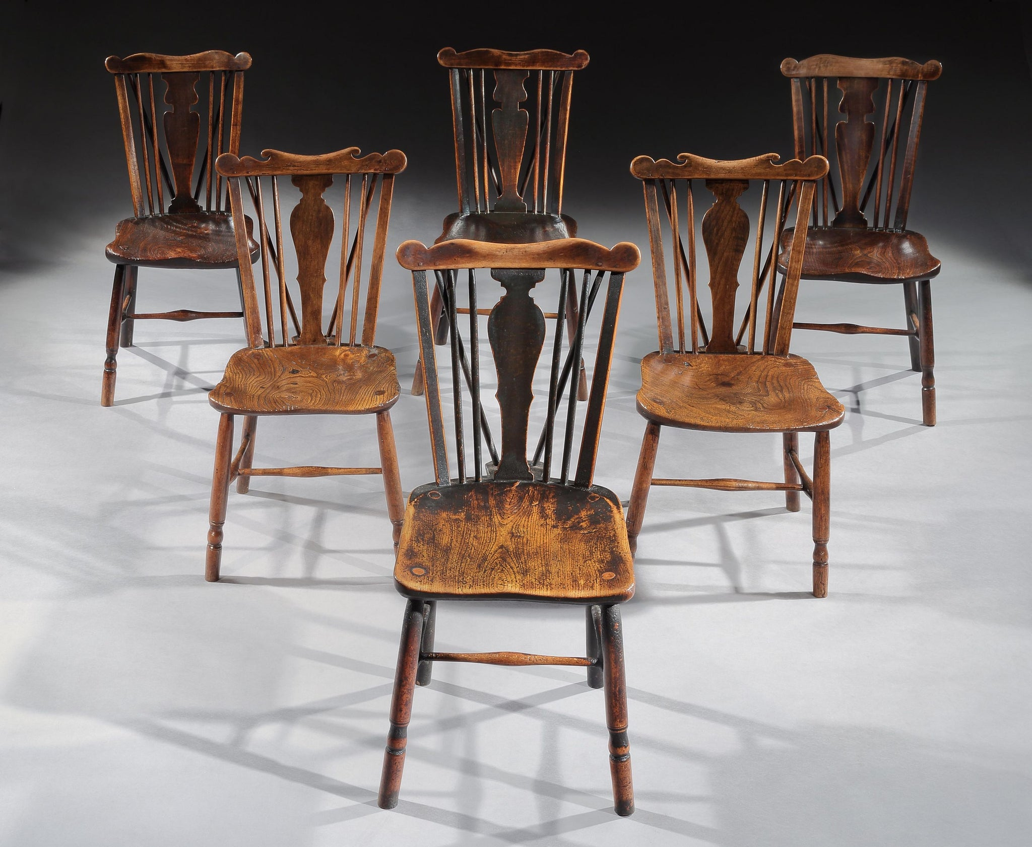 A Good Matched Set of Six Early Comb Back Windsor Chairs