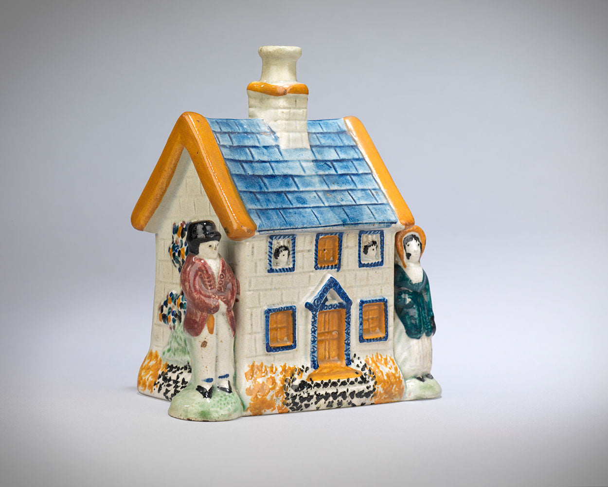 A Delightful Prattware Cottage Money Box