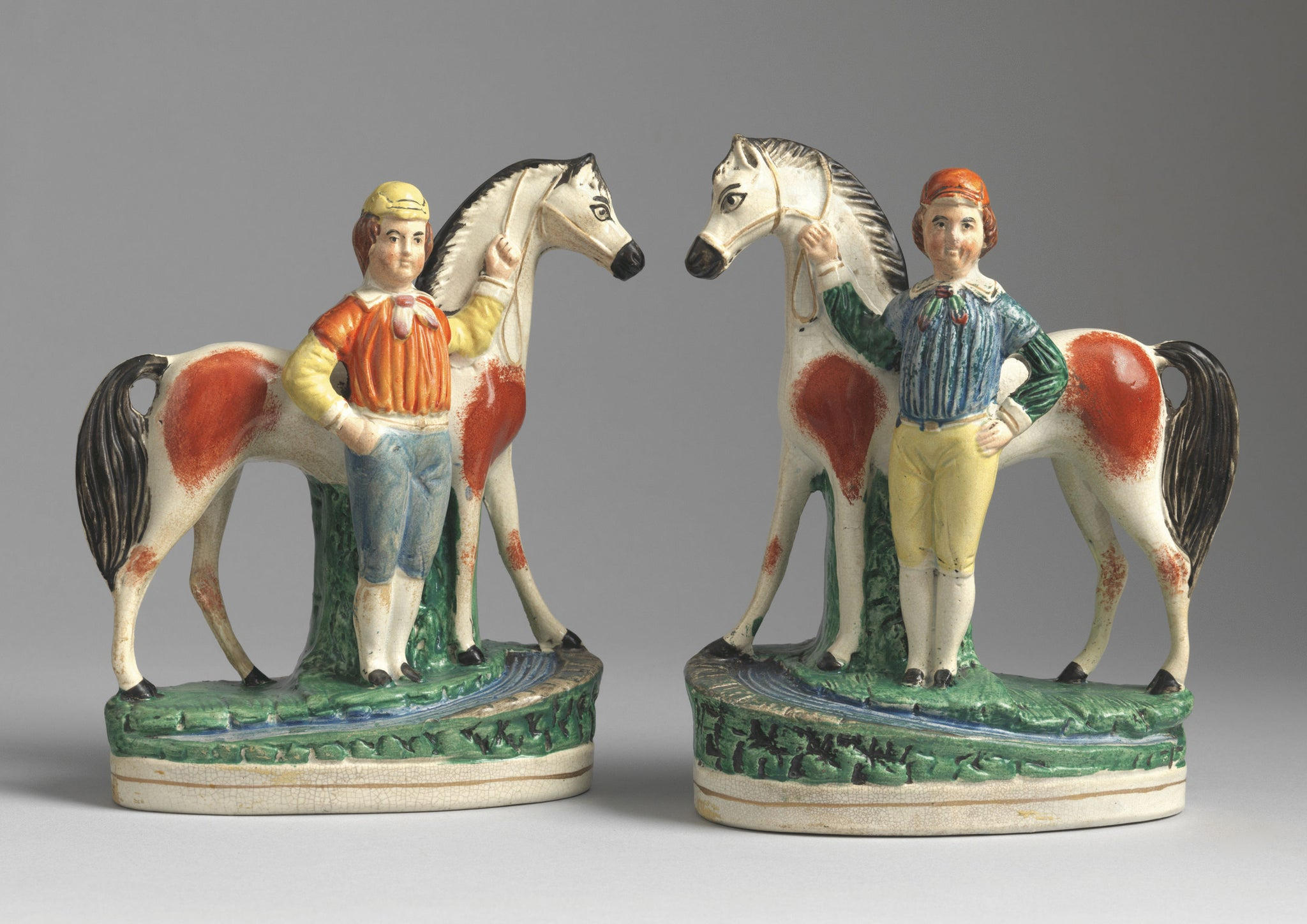 A Pair of Primitive Equestrian Figures