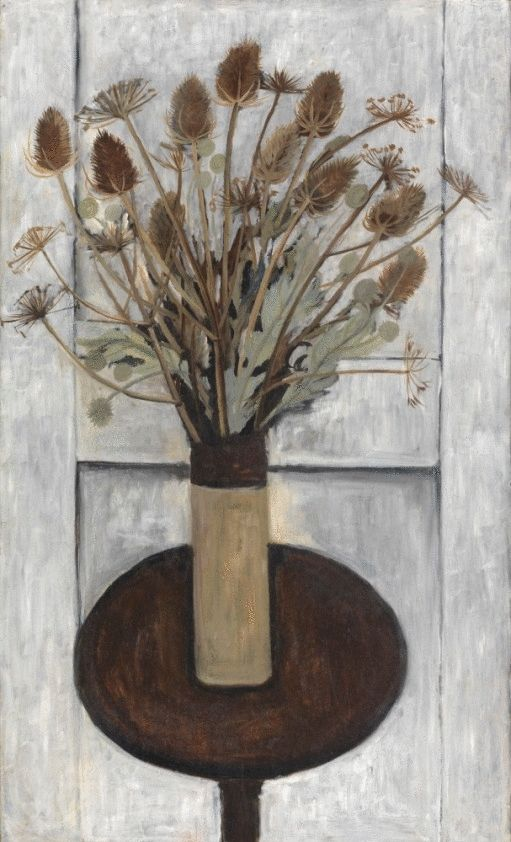 Vase of Tall Dried Flowers on the Round Table