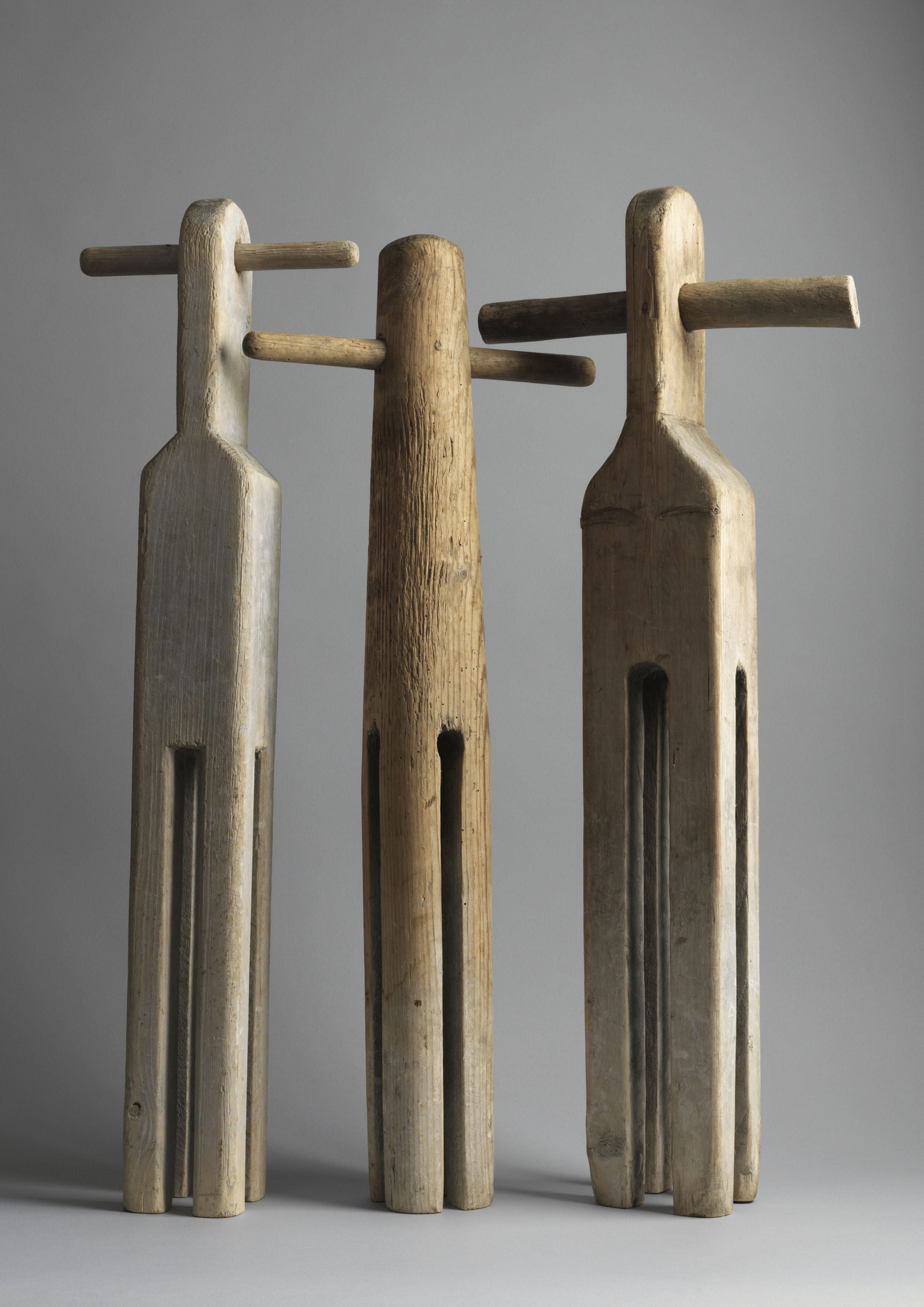A Collection of Three Sculptural Washing Dollies