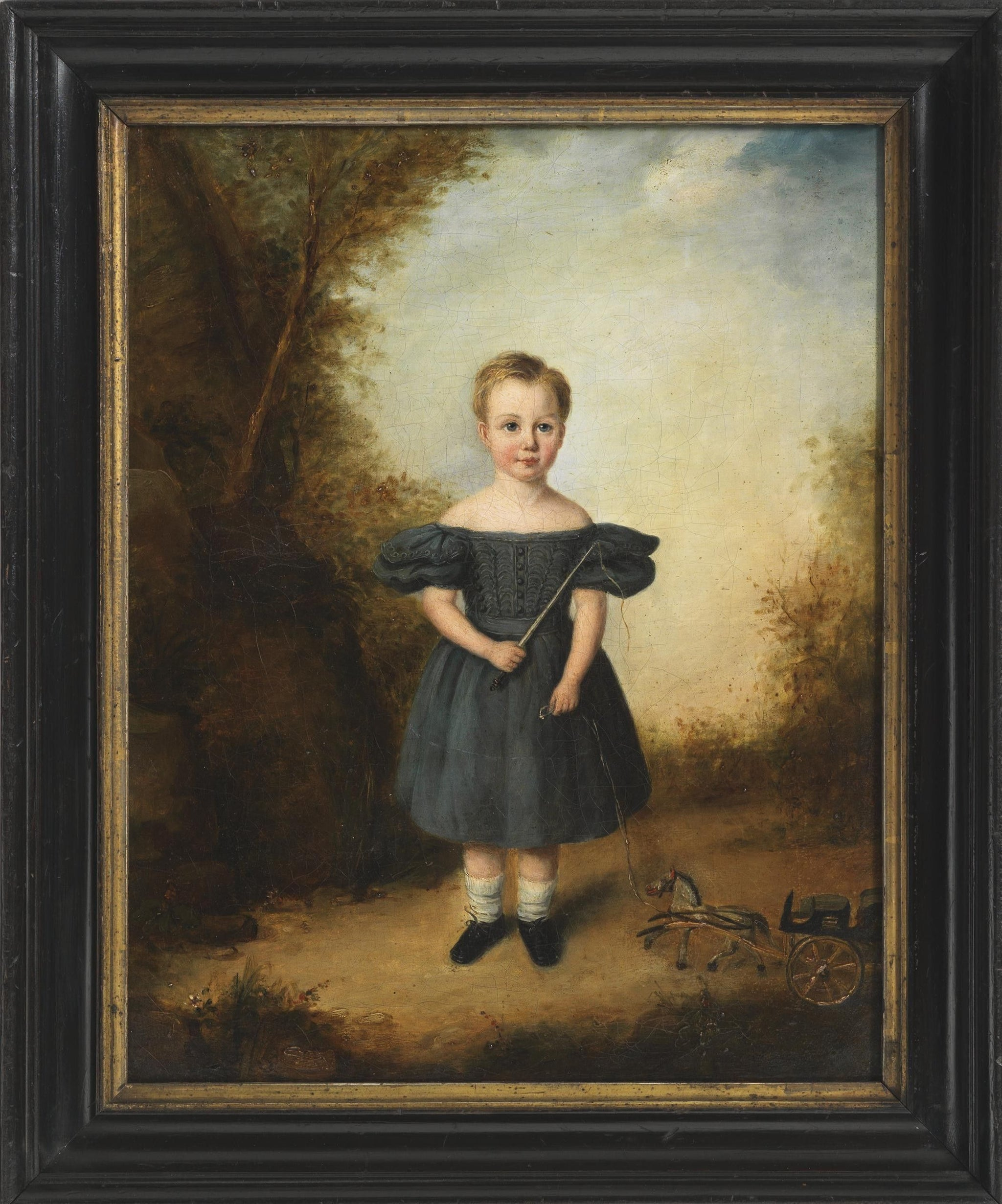Portrait Of A Child With Toy Horse and Cart
