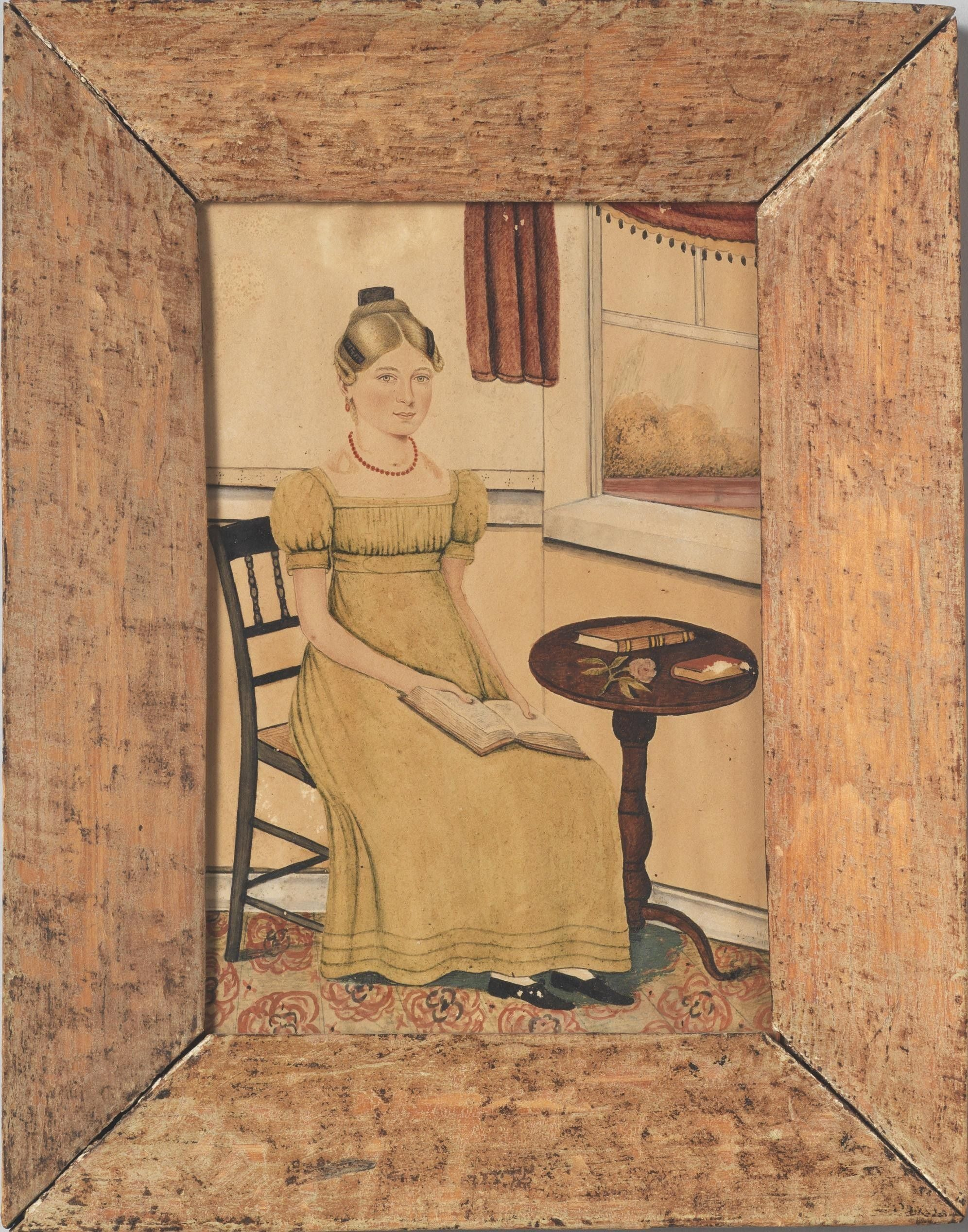 Seated Girl Reading At A Table