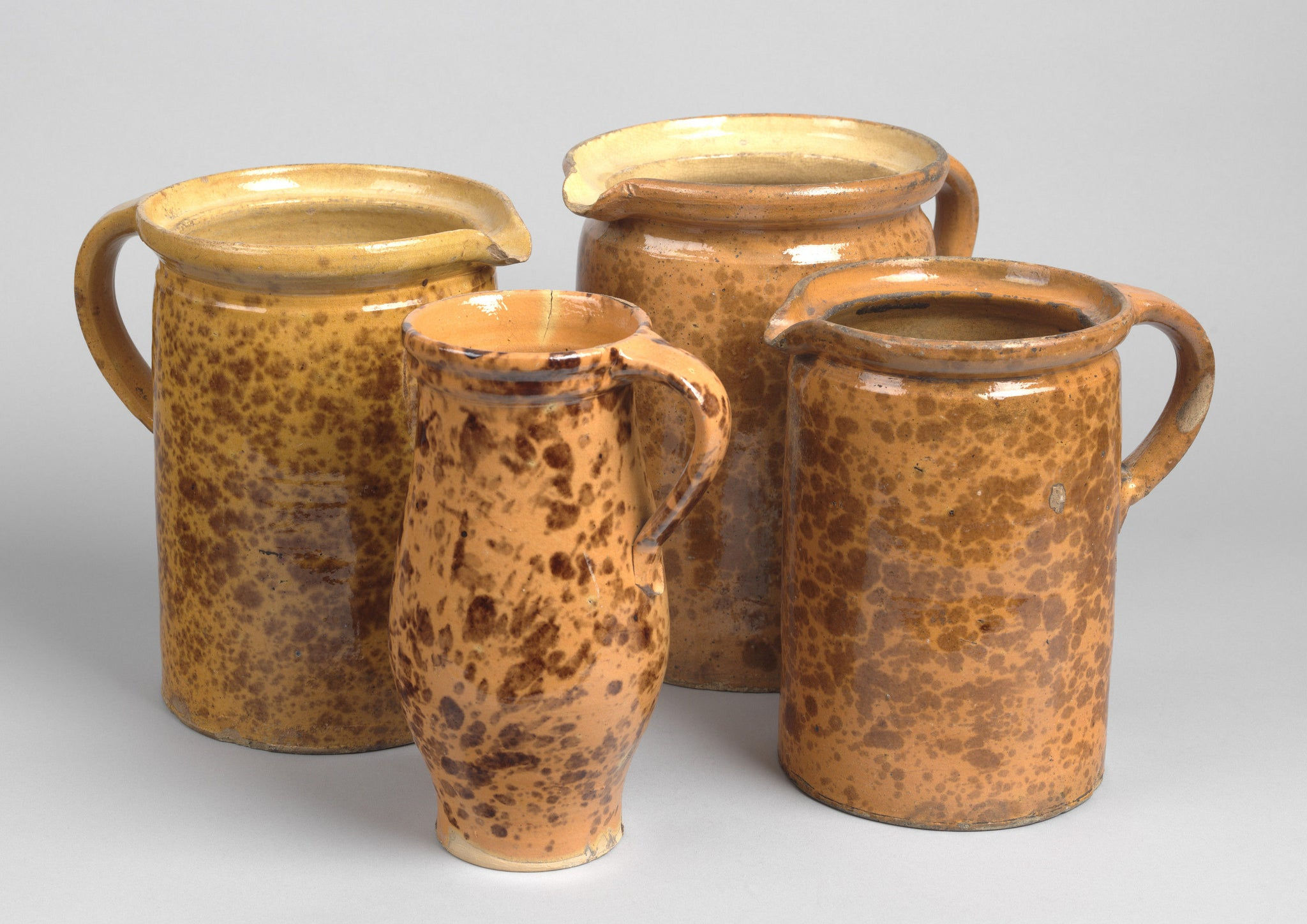 A Collection of Four Splatterglazed Jugs