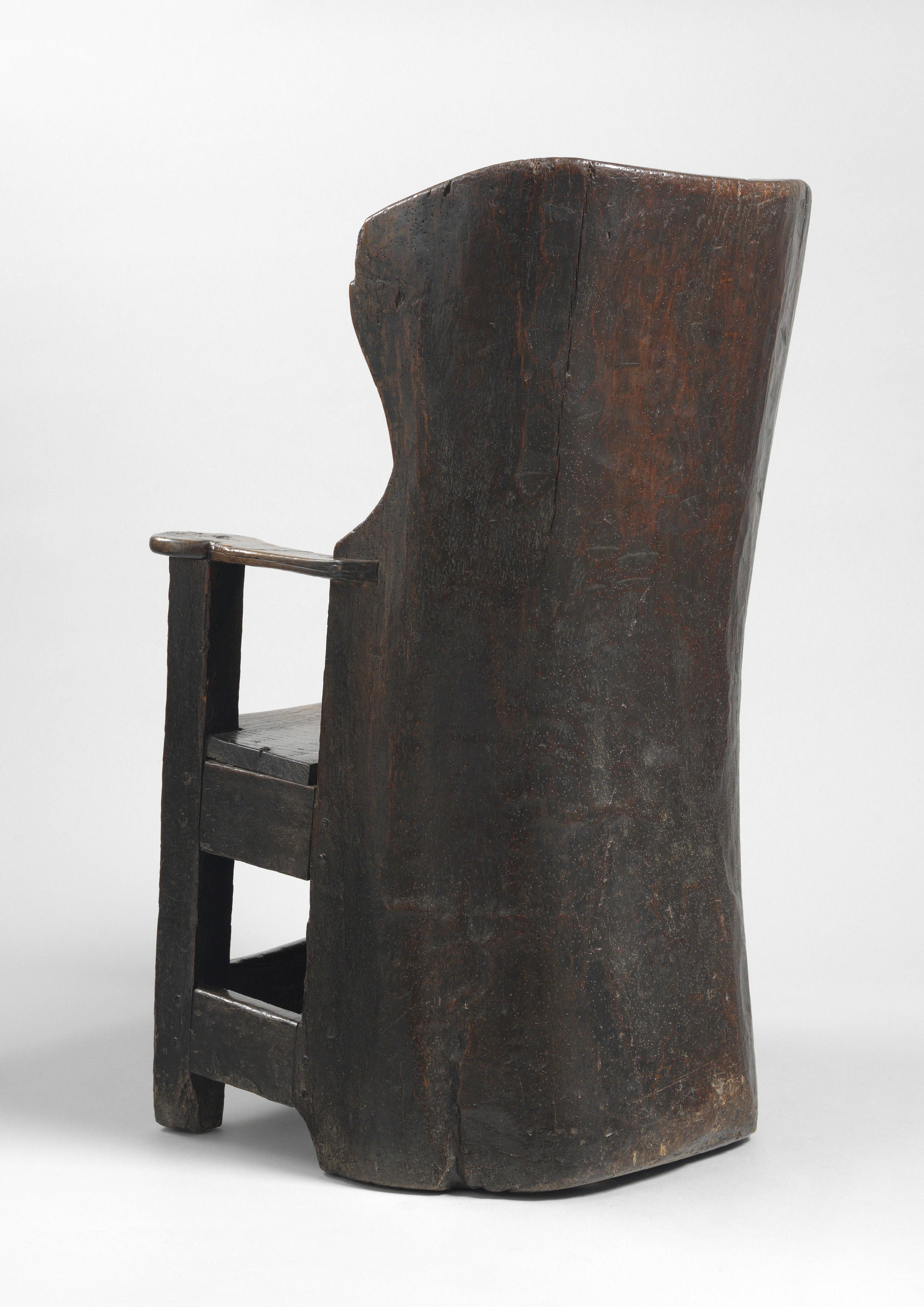 A Rare and Sculptural Early 'Dug Out' Wing  Chair