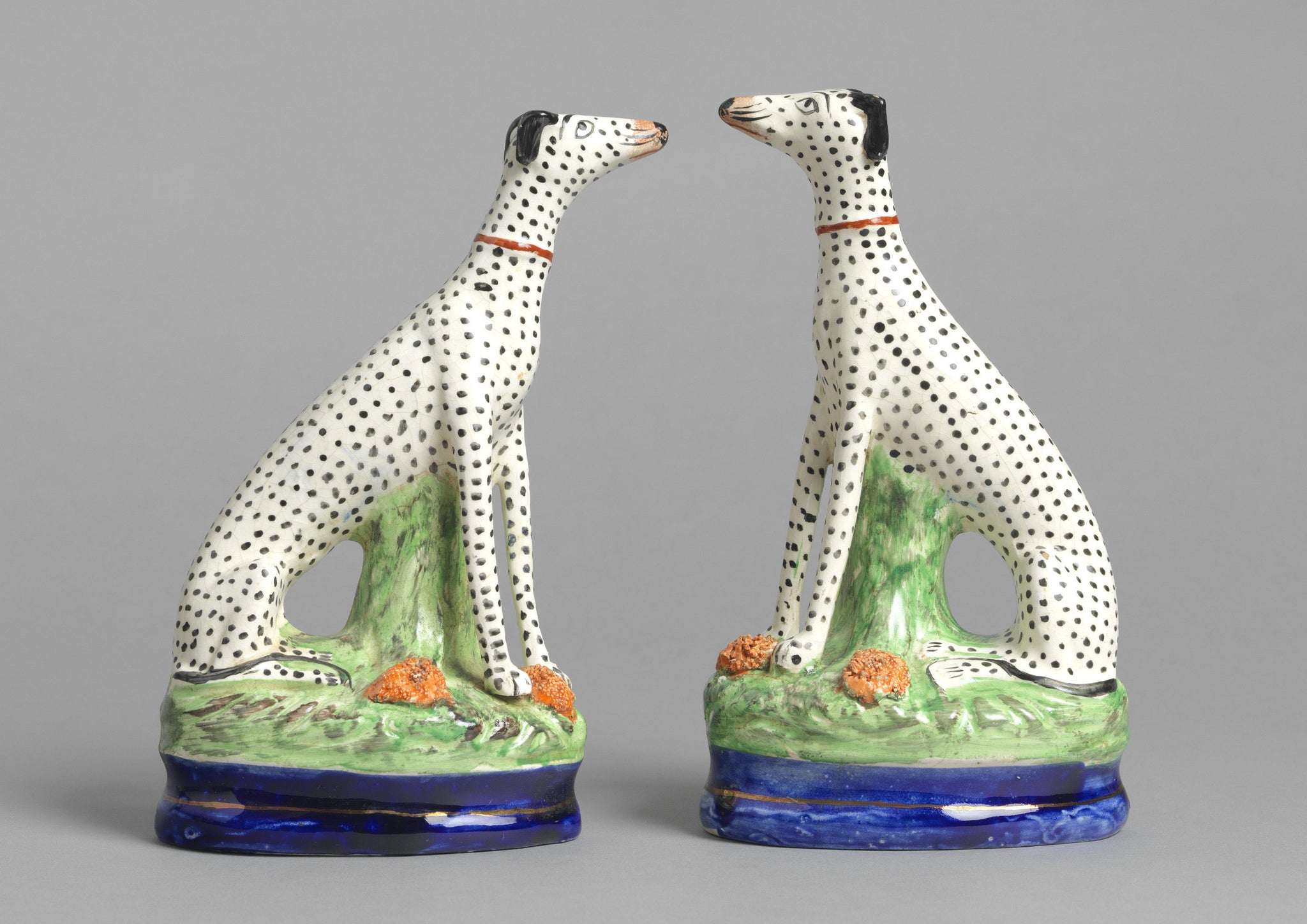 Pair Of Seated Dalmations