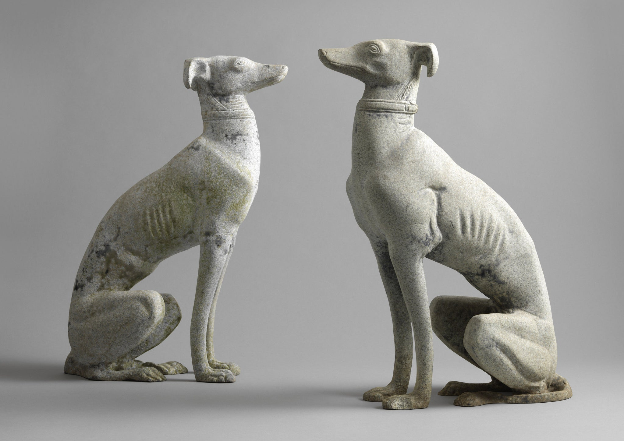 A Pair Of Seated Greyhounds