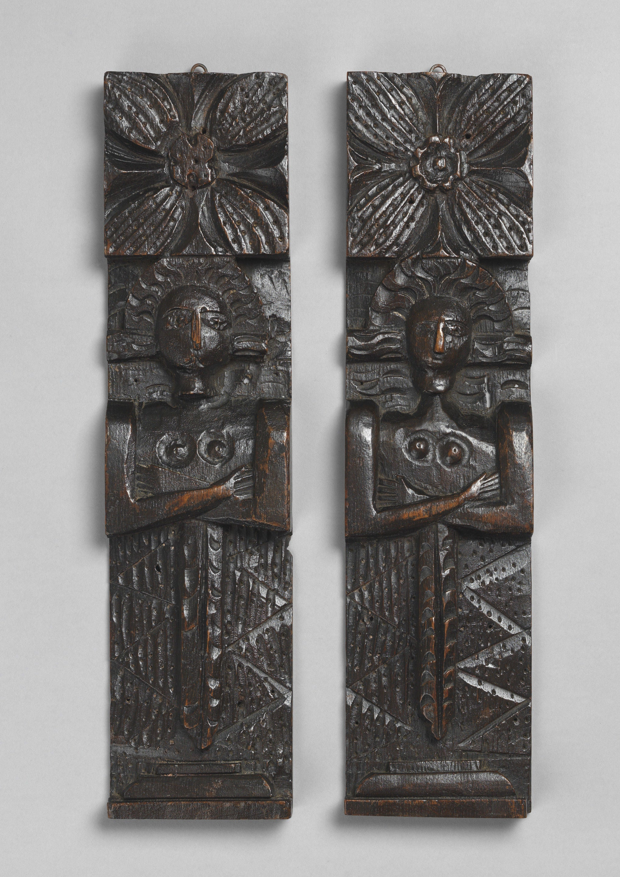 Pair of Primitive Figure Carved Terms or 'Caryatids'