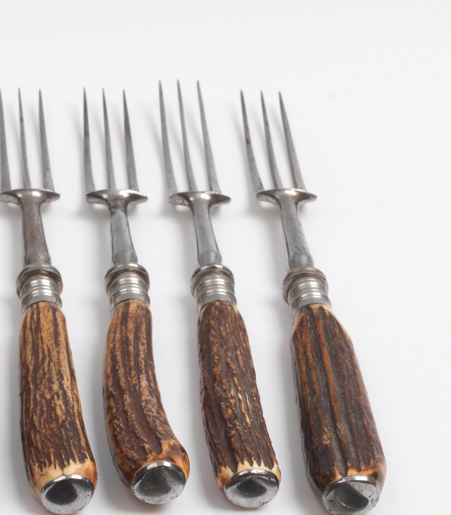 A Full Set of Twelve Stags Horn Handled Knives and Forks